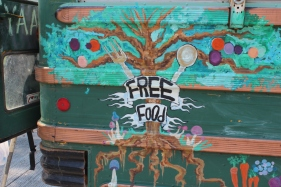 Free Food offered by hippies with a school bus converted into a kitchen at Liberty Park 2013